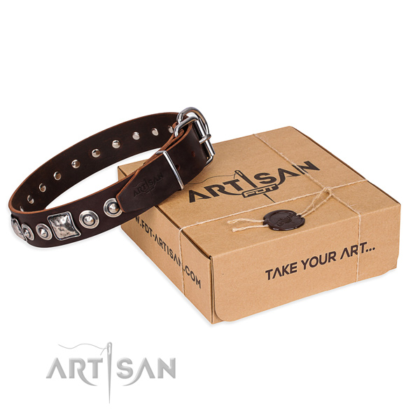 Genuine leather dog collar made of gentle to touch material with strong hardware